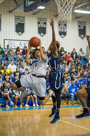 2/16/2018 - Blake senior guard Donnell Whitmore (1) looks to shoot over Springbrook defender Timitrius Whitney-Hawkins (14), Springbrook v Blake Boys Basketball, ©2018 Jacqui South Photography
