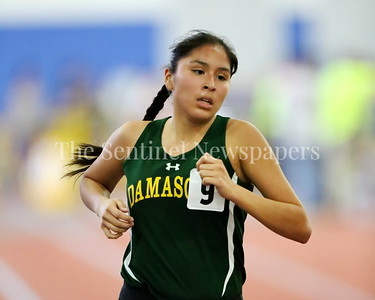 George P. Smith/The Montgomery Sentinel    AMontgomery Sentinel    Damascus High School's Alexis Whitehorn-Coriz in the Girls 2A Division 1600 meter Run at the State Indoor Track & Field Championship Meet held at the Prince George's Sports and Learning Center in Landover, MD on Monday February 19, 2018.