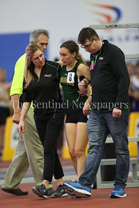 George P. Smith/The Montgomery Sentinel    Montgomery Sentinel    Damascus High School's Juliana Ancalmo being helped off the track at the State Indoor Track & Field Championship Meet held at the Prince George's Sports and Learning Center in Landover, MD on Monday February 19, 2018.