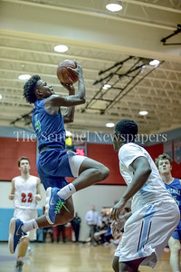 Churchill's TJ Richardson finds an opening and drives to the hoop against Einstein. PHOTO BY MIKE CLARK