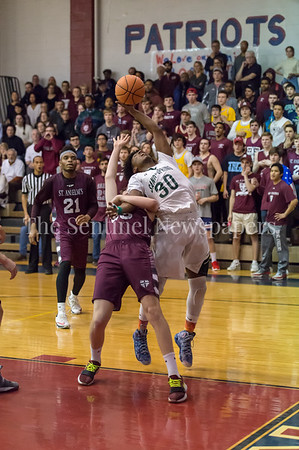 2/24/2018 - Kyle Whitlock (35) and Shields Kiggs (30) battle for a rebound in the PVAC Championship,  St. Anselm's Abbey v Sandy Spring Friends, ©2018 Jacqui South Photography