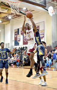 Senior Bobby Miller of Paint Branch floats up under the rim to put the ball in for two. Photo Credit:  David Wolfe