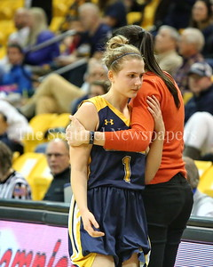 George P. Smith/The Montgomery Sentinel    In a tender moment between player and coach, senior Eve McGloon (#1) hugs Coach Ryan Ingallls as she comes off he court for the last time in her high school career. BCC gave up a 17 point lead to lose to Catonsville High School by a score of 63-51, a 29 point swing. It was BCC's first trip to the State semifinals.