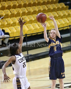 George P. Smith/The Montgomery Sentinel    Bethesda-Chevy Chase High School's Charlotte Lowndes was uncharacteristically 0-6 from beyond the arc likely compounded by having a hand in her face most of the day, such as that of Catonsville High School's Jasmine Dickey (#20).