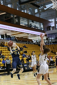 George P. Smith/The Montgomery Sentinel    Bethesda-Chevy Chase High School's Charlotte Lowndes (#11) with the jump shot in a loosing effort that saw the Barons fall to Catonsville High School 63-51 in the State semifinal game played at at Towson University on March 8, 2018. At one point the Barons led by 17 points.