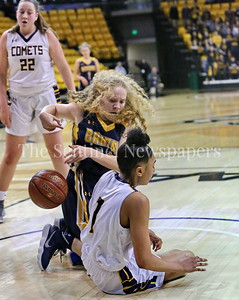 George P. Smith/The Montgomery Sentinel    Bethesda-Chevy Chase High School's ferocious Stephanie Howell (#14) rips the ball out of the hands of Catonsville's Jameila Barrett (#1) trying to avoid a jump ball.