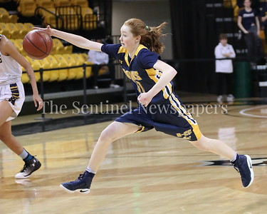 George P. Smith/The Montgomery Sentinel    Bethesda-Chevy Chase High School's Charlotte Lowndes (#11) chases down a loose ball during the State semifinal game against Catonsville High School.