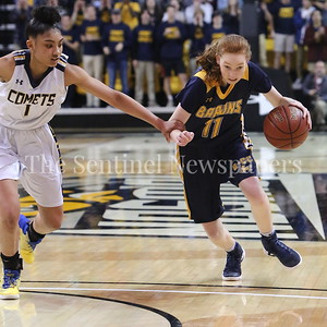 George P. Smith/The Montgomery Sentinel    No foul here .... Catonsville High School's Jameila Barrett (#1) grabs Bethesda-Chevy Chase High School's Charlotte Lowndes (#11) as the senior point guard brings the ball upcourt trying to push the tempo.