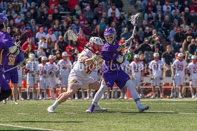 3/10/2018 - Albany attack Connor Fields (5) guarded by Maryland  defender Curtis Crley (42), Albany v Maryland Men's Lacrosse, ©2018 Jacqui South Photography