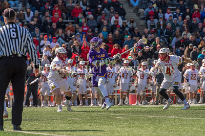 3/10/2018 - Albany attack Connor Fields (5) guarded by Maryland defender Curtis Crley (42) & help by defender Bryce young (41), Albany v Maryland Men's Lacrosse, ©2018 Jacqui South Photography