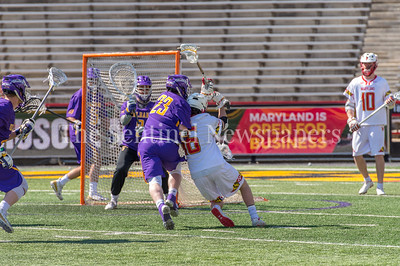 3/10/2018 - middie Jack Burgmaster (23) pushing out Maryland's attack Anthony DeMaio (16), Albany v Maryland Men's Lacrosse, ©2018 Jacqui South Photography