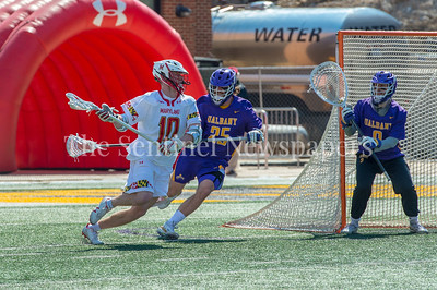 3/10/2018 - Maryland attack Jared Bernhardt (10) guarded by Ddefender Stone Sims (25), Albany v Maryland Men's Lacrosse, ©2018 Jacqui South Photography