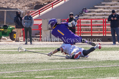 3/10/2018 - Albany attack Tehoka Nanticoke (1), Maryland defender Bryce young (41), Albany v Maryland Men's Lacrosse, ©2018 Jacqui South Photography