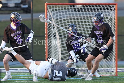 George P. Smith/The Montgomery Sentinel    Georgetown Prep's Connor Humiston (#21) takes a diving shot at Gonzaga goalie Tim Marcille (#15) in the game Friday, March 16, 2018 that the Little Hoya's would win at home in overtime by a score of 7-6.