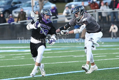George P. Smith/The Montgomery Sentinel    Georgetown Prep's Andrew Cave (#9) with the stick check on Gonzaga's Doane Kiechel (#19).