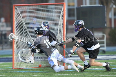 George P. Smith/The Montgomery Sentinel    Georgetown Prep's Kaleb Fernandez (#16) takes a diving shot against Gonzaga's Tim Marcille (#15).