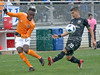 Joseph Mora of DC United charges in to try and block the shot on goal by Houston's Alberth Elis. PHOTO BY MIKE CLARK