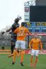 Darren Mattocks of DC United heads this inbound throw forward against Houston Dynamo's Leonardo. PHOTO BY MIKE CLARK