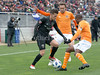 Houston Dynamo's DaMarcus Beasley and Dylan Remick smother DC United's Zoltán Stieber. The Dynamo applies a stiff defense all game.