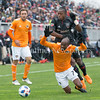 Houston Dynamo's DaMarcus Beasley positions in front of the steamrolling Darren Mattocks of DC United. PHOTO BY MIKE CLARK