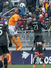Houston Dynamo's Romell Quioto elevates and out jumps DC United's Chris Durkin on this second half header. PHOTO BY MIKE CLARK