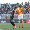 Darren Mattocks of DC United heads this shot and out-positions Houston Dynamo's Adolfo Machado. PHOTO BY MIKE CLARK