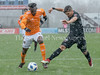 Alberth Elis of Houston races against DC United's defender Joseph Mora in the March 17 snow. PHOTO BY MIKE CLARK