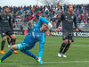 Goalkeeper David Ousted of DC United stretches to block a wide shot attempt. Despite the cold and later snow, DC United earned a 2-2 tie against the Houston Dynamo.  PHOTO BY MIKE CLARK