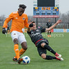 DC United's utilizes his speed to slide in and break up  Houston Dynamo's Alberth Elis shot attempt. PHOTO BY MIKE CLARK