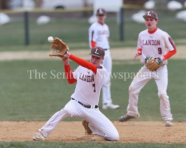 George P. Smith/The Montgomery Sentinel    Landon's Ryan Fruehwirth (#7) stopping a crisply hit line drive.