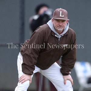 George P. Smith/The Montgomery Sentinel    Landon's head coach Bill Reed watches the Sidwell Friends pitcher intently from the 3rd base  coaches box.