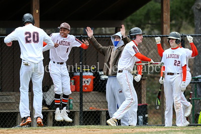 George P. Smith/The Montgomery Sentinel    The Landon dugout celebrates after Dane Camphausen (#20) crosses home plate.