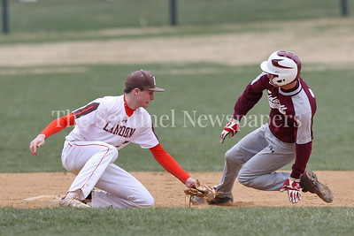 George P. Smith/The Montgomery Sentinel    Landon's Ryan Fruehwirth (#7) goes for the tag as he Sidwell Friends' runner slides behind him.