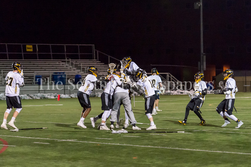 3/23/2018 - Richard Montgomery celebrate 7-6 win over B-CC in the season opener, B-CC v Richard Montgomery Boys Lacrosse, ©2018 Jacqui South Photography