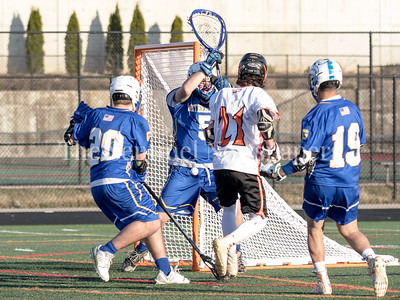 Goalie Jake Keeley of Gaithersburg blocks Rockville's Mark Shaefer's shot on goal with his body. PHOTO BY MIKE CLARK