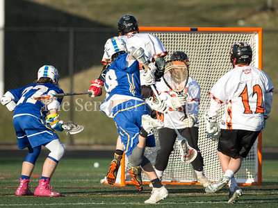 Rockville Goalie Jack Welch blocks this hard shot on goal by Gaithersburg's Travis Martinez. PHOTO BY MIKE CLARK