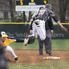 Poolesville's Colin Metz tries to avoid the tag at first by B-CC's Nils Townsend but Townsend and the rest of the B-CC defense locked down Poolesville in the late innings. PHOTO BY MIKE CLARK