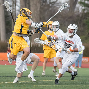Robert Schain (19) of Bullis gets a shot off against the tough Landon defense but was stopped by Landon's Goalie Mitchell Laughlin who recorded 15 saves on the day. PHOTO BY MIKE CLARK
