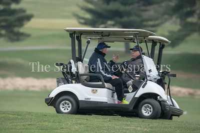 Bullis Golf Head Coach Shawn Kane and Good Counsel Head Coach Jim Estes discuss the play of their respective teams in less than perfect weather. PHOTO BY MIKE CLARK
