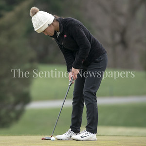Bullis Golfer Sophie Simon's lines up for a par putt vs Good Counsel at Great Falls Road Golf Course. PHOTO BY MIKE CLARK