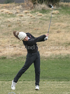 Bullis Golfer Sophie Simon's perfect swing led to long and accurate drives - even in the cold weather with scattered snow flakes at Great Falls Road Golf Course. PHOTO BY MIKE CLARK