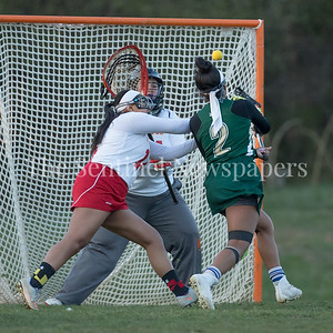 Kennedy's Aalayah Dorsey (2) fires one of her four goals past the Wheaton defense.  PHOTO BY MIKE CLARK