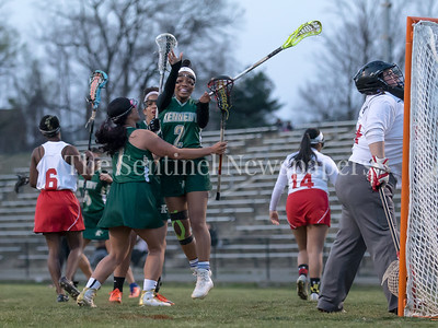 Kennedy's Aalayah Dorsey (2) celebrates her goal as she's mobed by teammates. Dorsey hit on four goals in the 6-3 win over rival Wheaton.  PHOTO BY MIKE CLARK