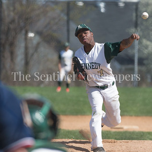 The Kennedy piitchers were hammered during a double-header with rival Wheaton HS. Here Rafelo Perel, who started the 2nd game, just couldn't stop the Wheaton bats. PHOTO BY MIKE CLARK