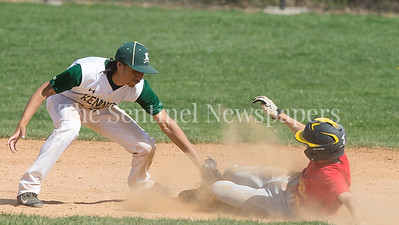 Wheaton Shortstop Luc Bartusek beats the tag by Kennedy's Ricky Vasquezon on this steal of second. Kennedy baserunners filled the bases in both games of the double-header with 11-1 and 15-2 victories over rival Kennedy. PHOTO BY MIKE CLARK