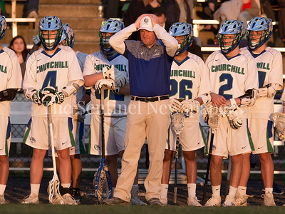 Churchill's Varsity Lacrosse Head Coach Jeff Fritz is recognized for his 25 years of coaching at Churchill and rewarded with an 18-7 win on senior night. PHOTO BY MIKE CLARK