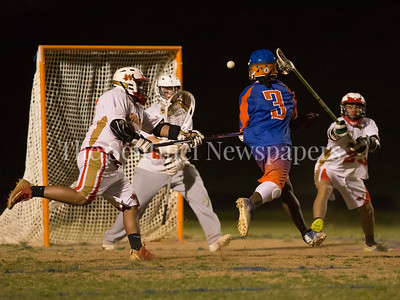 Watkins Mill's Hezekiah Likekele (3) fires on Wheaton Goalie Dylan Rich (27). Rich started strong but the Watkins Mill offense proved too strong in the 6-2 win. PHOTO BY MIKE CLARK