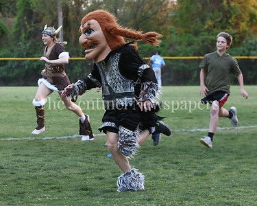 George P. Smith/The Montgomery Sentinel    The mascot race between innings at Walt Whitman High School Baseball Program's community night.