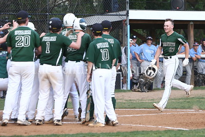 George P. Smith/The Montgomery Sentinel    Damascus High School's Ethan Wentzlaff (27) approaches home plate surrounded by teammates after taking the 1st pitch of the game for a home run.