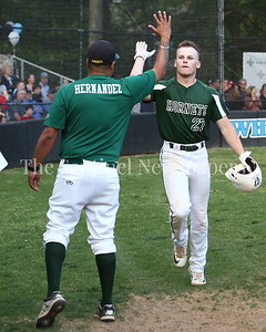 George P. Smith/The Montgomery Sentinel    Damascus High School's Ethan Wentzlaff (27) high fives Coach Hernandez after taking the 1st pitch of the game for a home run.